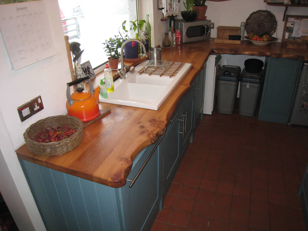 Corrie woodworking handmade kitchen 2 elm worksurface for Handmade kitchens