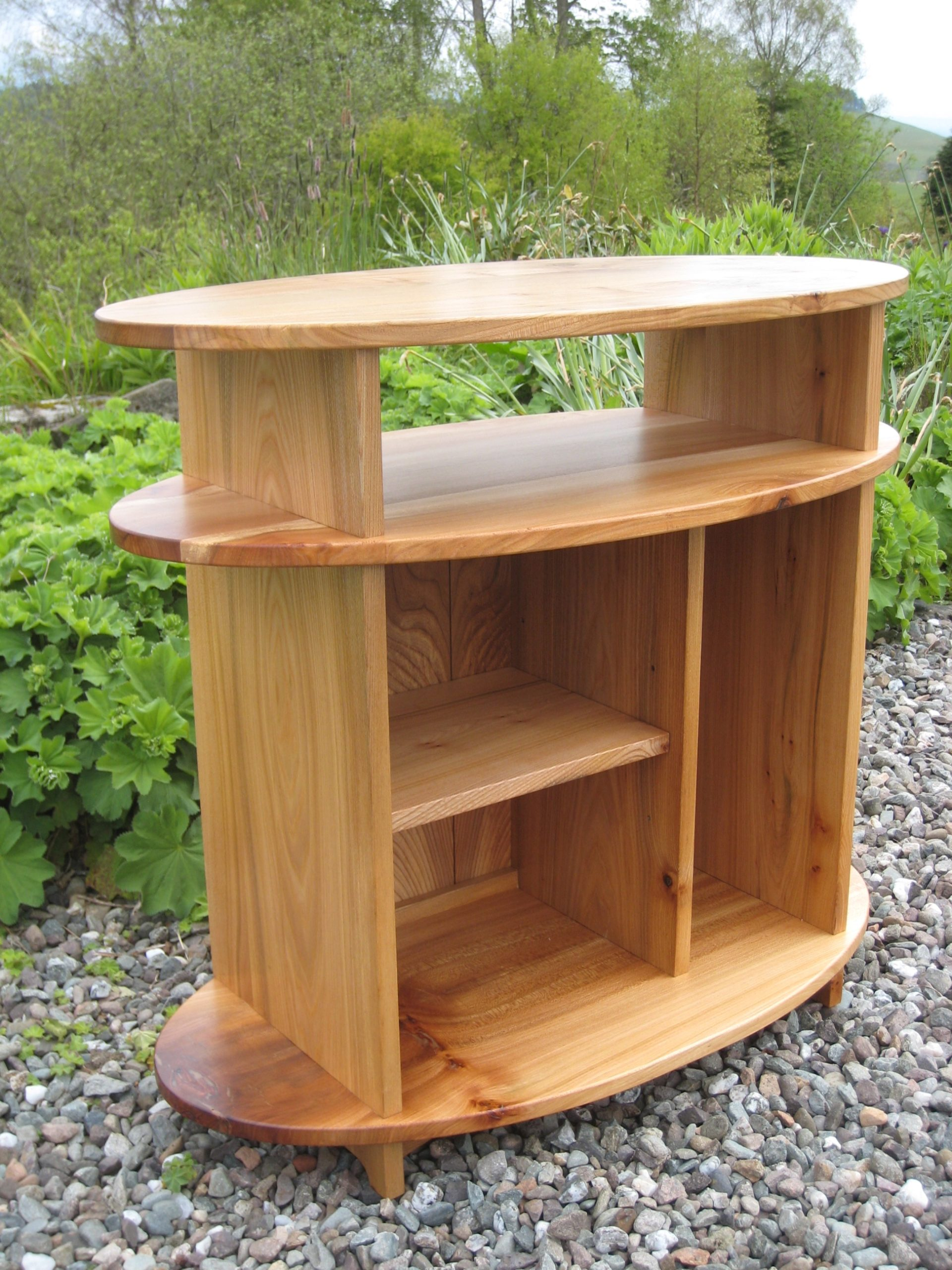 Oval TV stand in elm